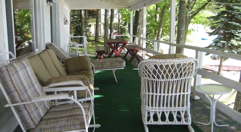 Cooperstown Vacation Rental - view from porch overlooking lawn and lake